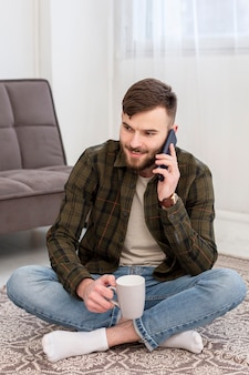 Portrait of entrepreneur talking on the phone from home