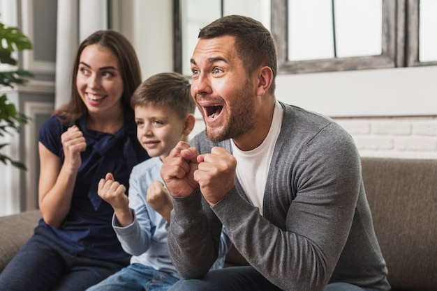 Portrait of excited family with son