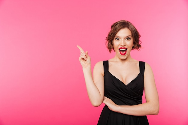 Portrait of an excited girl dressed in black dress