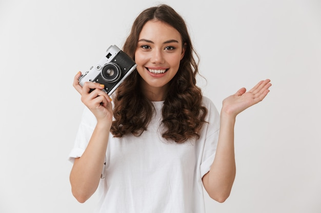 Portrait of an excited young casual brunette woman