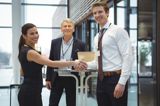 Portrait of executive shaking hands