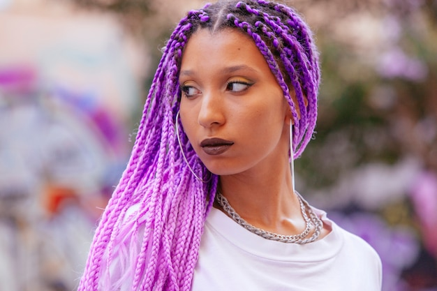 Portrait of an exotic woman with ultra violet braids