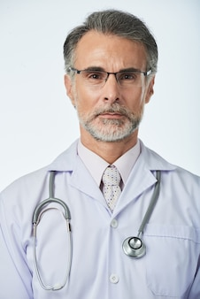 Portrait of experienced professional therapist with stethoscope looking at camera