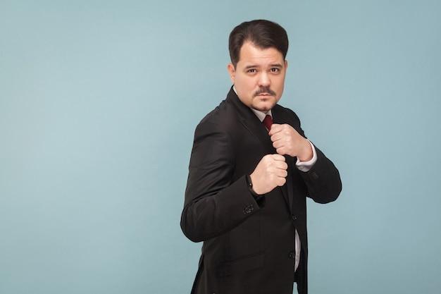 Portrait of expressive business man boxing