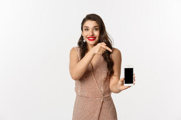 Portrait expressive young woman in elegant dress holding phone