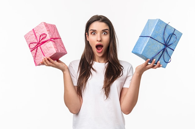 Portrait expressive young woman holding gifts