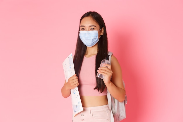 Portrait expressive young woman holding map and wearing mask