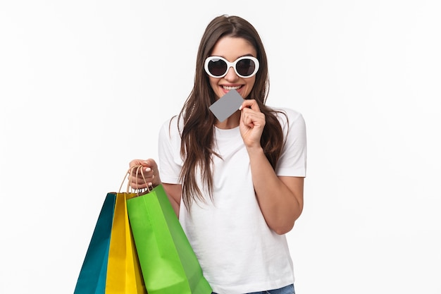 Portrait expressive young woman holding shopping bags
