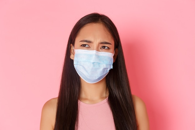 Portrait expressive young woman wearing mask