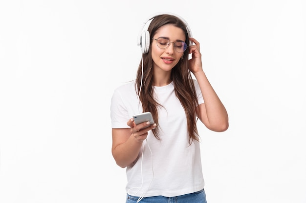 Portrait expressive young woman with mobile listening music