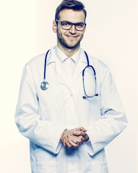 Portrait - a family doctor with stethoscope on white background