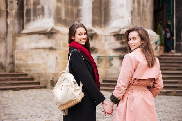 Portrait of fashion girls in coats.