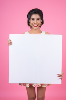 Portrait of fashion woman displaying white banner