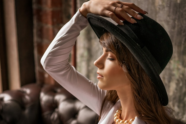 Portrait of fashion woman in hat , beautiful stylish
