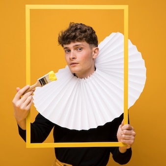 Portrait of fashionable boy wearing a ruff