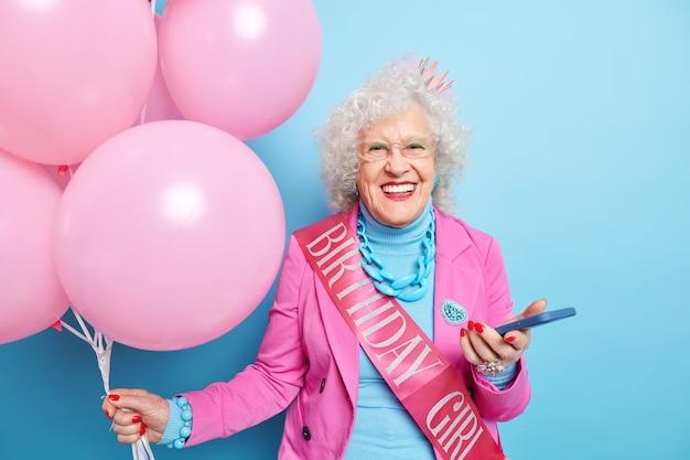 Portrait of fashionable elderly lady celebrates her birthday