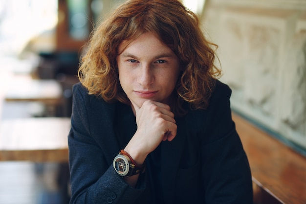 Portrait of fashionable reddish young man posing