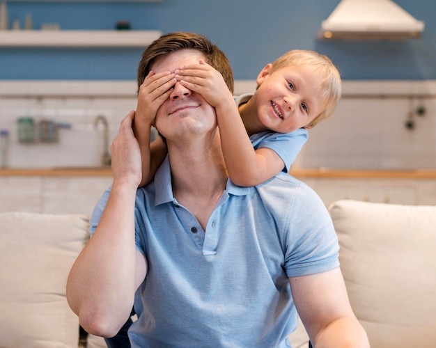Portrait of father playing with young boy