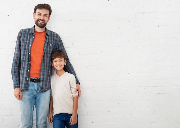 Portrait of father and son with copy space