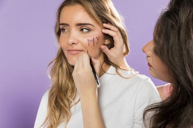 Portrait of female activist painting her face