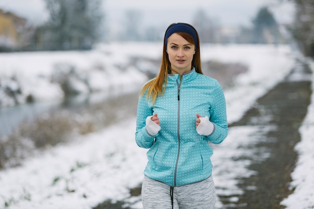 Portrait of female athlete in winter