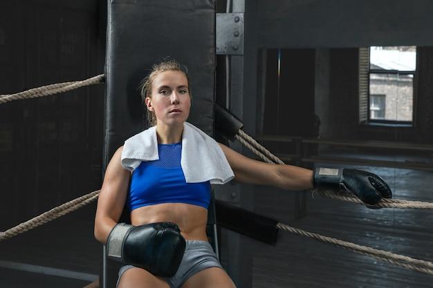 Portrait of a female boxer having a rest