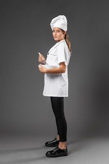 Portrait female chef with bowl mixing