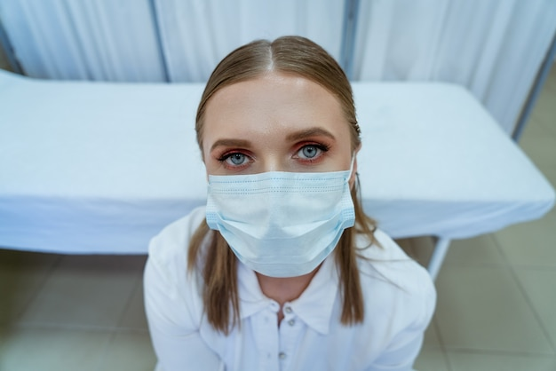 Portrait of female doctor in mask close up