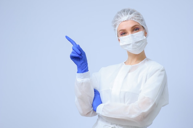 Portrait of a female doctor or nurse wearing medical cap and face mask
