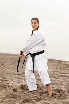 Portrait of female exercising karate