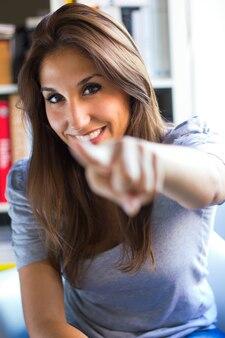 Portrait of female gesticulating finger
