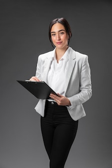 Portrait female lawyer in formal suit with clipboard