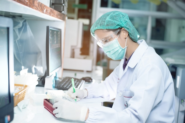 Portrait of a female researcher working in a lab