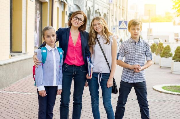 Portrait of female teacher with children