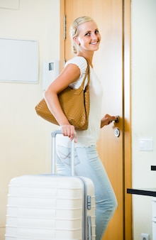Portrait of female traveller going at holiday trip