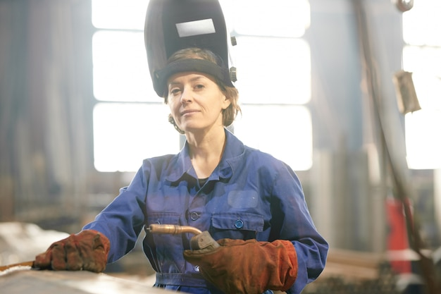 Portrait of female welder