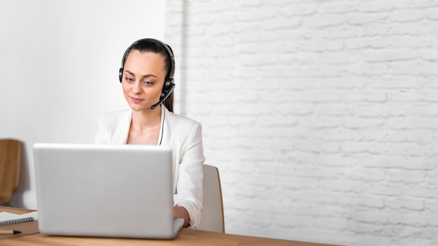 Portrait female at work having video call