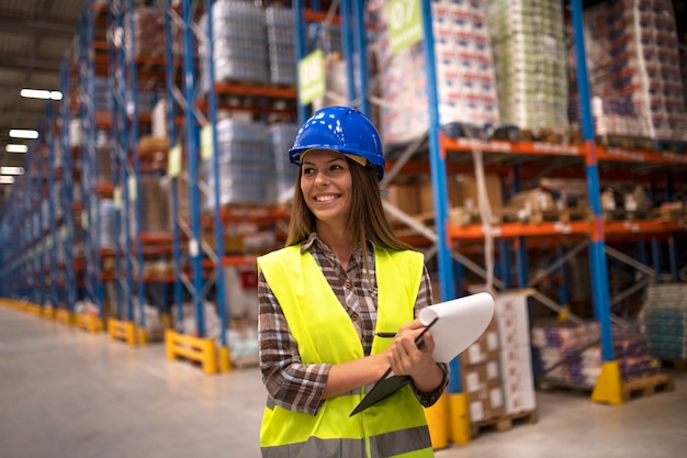 Portrait of female worker in distribution warehouse looking aside