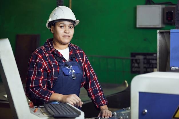 Portrait of female worker on green