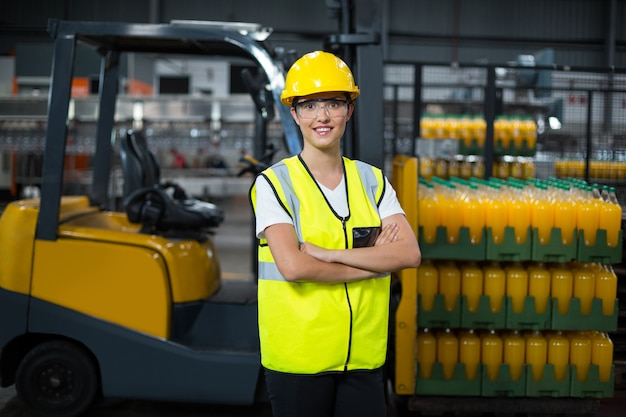 Portrait of female worker standing with arms crossed