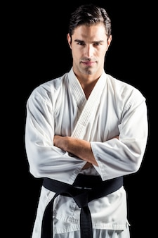 Portrait of fighter standing on black background