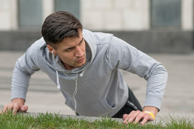 Portrait of fit male doing push ups
