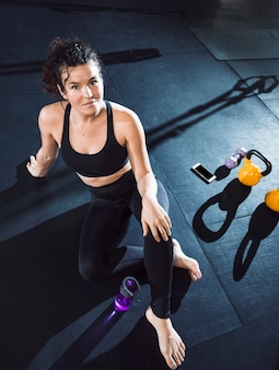 Portrait of a fit woman in fitness club