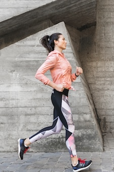 Portrait of fit woman jogging outdoor