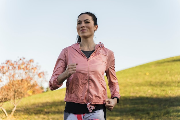Portrait of fit woman running in the park