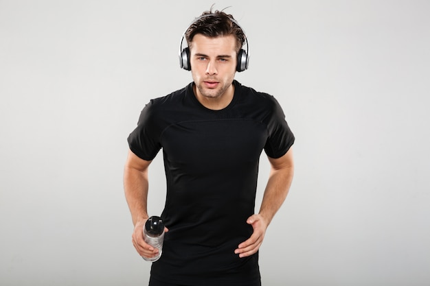 Portrait of a fit young sportsman listening to music
