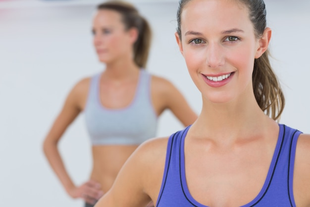 Portrait of fit young women in sports bra at fitness studio