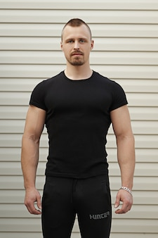 Portrait of fitness instructor with arms crossed