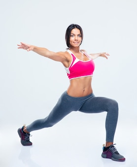 Portrait of a fitness woman stretching