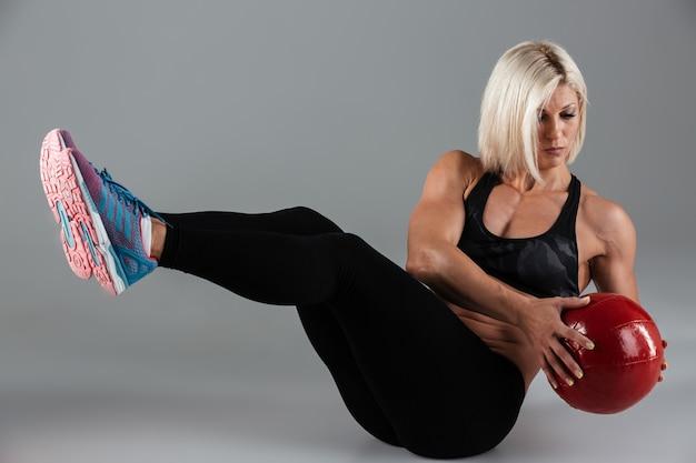 Portrait of a focused muscular adult sportswoman